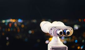 Touristic telescope look at city with view of Barcelona Spain, close up old metal binoculars on background viewpoint stock image