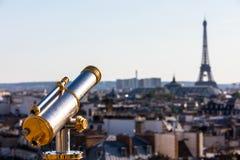 Touristic telescope overlooking Eiffel Tower Stock Photo