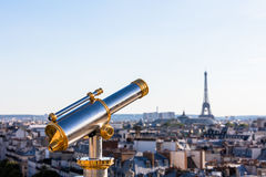 Touristic telescope overlooking Eiffel Tower from the roof of Pr Stock Image
