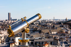 Touristic telescope overlooking Paris from the roof of the building.  France Royalty Free Stock Images
