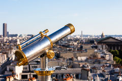 Touristic telescope overlooking Paris from the roof of Printemps Stock Image