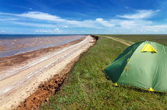 Touristic tent in astrakhan steppe under beautiful sky. Panorama of nature near salt lake Baskunchak royalty free stock photography