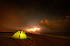 Touristic tent on the beach by night Royalty Free Stock Images