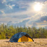 Touristic tent on a forest glade Stock Photos