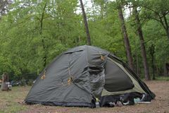 Touristic tent in a forest. Many sneakers stock image