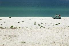 Touristic tent on the sea coast of wild island Stock Image
