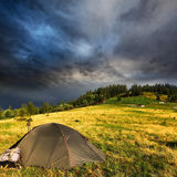 Touristic tent and storm clouds Royalty Free Stock Photo