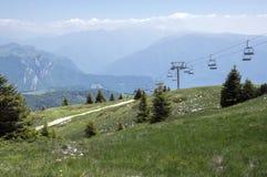 Touristic trail Alta Via del Monte Baldo, ridge way in Garda Mountains, chair lift Royalty Free Stock Photo