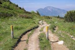 Touristic trail Alta Via del Monte Baldo, ridge way in Garda Mountains, wooden sticks defining the way. Touristic trail Alta Via del Monte Baldo, ridge way in Stock Image