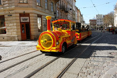 Touristic train goes through the street Royalty Free Stock Photos
