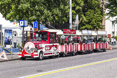 Touristic train in Lugano waiting for tourists. Lugano - april 27, 2014: Touristic train in Lugano waiting for tourists to carry them around Stock Photography