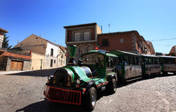 Touristic Train in Spain. A touristic train pass trough the medieval city of Avila, one of the preferred touristic attraction near Madrid, Spain royalty free stock images