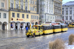 Touristic train at street of old city. Royalty Free Stock Images