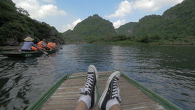 Touristic traveling by boat in Trang An, Vietnam stock video footage