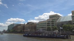 Touristic trip with a boat on Thames River Crossing the London Downtown.  stock footage