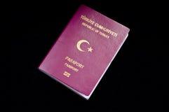 Touristic Turkish passport. On the black background Stock Photos