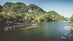 Touristic Vietnam Tam Coc, Ninh Binh. Timelapse. Touristic Vietnam Tam Coc, Ninh Binh.Time lapse with a lot of boat ride tourists around the valley stock video footage