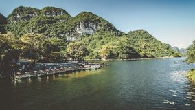 Touristic Vietnam Tam Coc, Ninh Binh. Timelapse. Touristic Vietnam Tam Coc, Ninh Binh.Time lapse with a lot of boat ride tourists around the valley stock footage