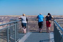 Touristic viewpoint at an opencast mine in Germany. JACKERATH, GERMANY - JULY 7, 2018: Skywalk with unknown people at the Garzweiler open pit brown coal mine royalty free stock photos