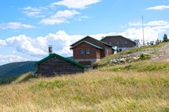Touristic wooden cottage on the top of mount Serak stock images