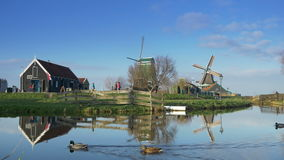 Touristic wooden houses and windmills at the Zaanse Schans. Holland 4K stock video footage