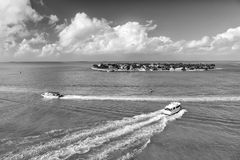 Touristic yachts floating by green island at Key West, Florida Royalty Free Stock Photos