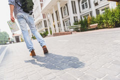 Touristic young man walking in city Stock Photography