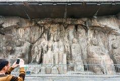 Touristisch machen Sie Foto geschnitzter Buddha-Zahl Lizenzfreie Stockfotografie