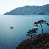 Touristische Boote im Meer Ansicht über Adrasan-Bucht Lizenzfreies Stockbild