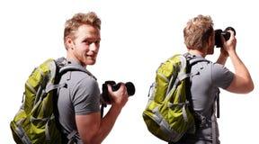 Touristische Gebrauchskamera des jungen Mannes Stockfotos