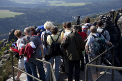 Tourists in the. A group of tourists in the Saxon Switzerland on the Schrammstones Royalty Free Stock Photography