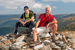 Tourists. Have a rest on the top of mountain massif Royalty Free Stock Photos