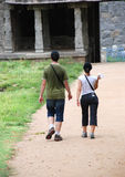 Tourists. Walking around a ancient building path Stock Photo
