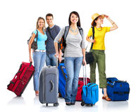 Tourists. Happy young people tourists. Isolated over white background Royalty Free Stock Photography