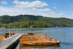 Tourists activities Bowness on Windermere Cumbria UK with rowing boats jetty Stock Photos