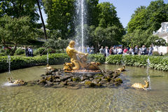 Tourists admire Greenhouse fountain with a sculpture of Triton, Royalty Free Stock Photography