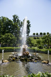 Tourists admire Greenhouse fountain with a sculpture of Triton, Stock Photography