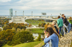 Tourists admiring the Olympic stadium in Olympiapark stock photo