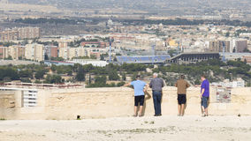 Tourists admire the surroundings of Alicante Royalty Free Stock Image