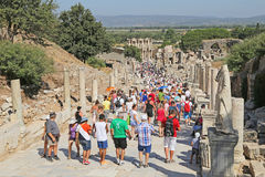 Tourists admiring ancient Greek and Roman Library Of Celsus at E Royalty Free Stock Photo