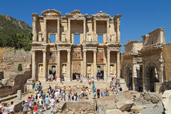 Tourists admiring ancient Greek and Roman Library Of Celsus at E Stock Photo