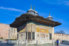 Tourists admiring fountain of Sultan Ahmed III, Istanbul Royalty Free Stock Images