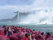 Tourists admiring Niagara Falls from the boat Royalty Free Stock Images