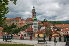 Tourists admiring the panorama of Cesky Krumlov city and the castle Stock Photo