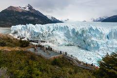 Tourists admiring Perito Moreno Glacier in Southern Patagonia Stock Photos
