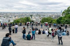 Tourists admiring the skyline of Paris from the Sacre Coeur Stock Images