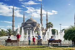 Tourists admiring the view of the fountain and Blue Mosque Royalty Free Stock Photography
