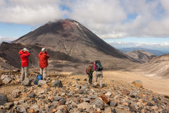 Tourists admiring volcano in Tongariro National Park. In New Zealand Royalty Free Stock Photos