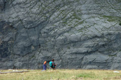 Tourists (adult and kid) nearby Grindelwald in Switzerland. Stock Photo
