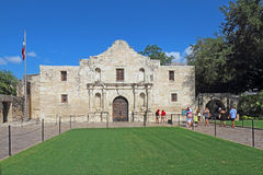 Tourists at the Alamo in San Antonio, Texas. Tourists visiting the chapel at the Alamo Mission, the former Mision San Antonio de Valero, at Alamo Plaza in San Royalty Free Stock Image